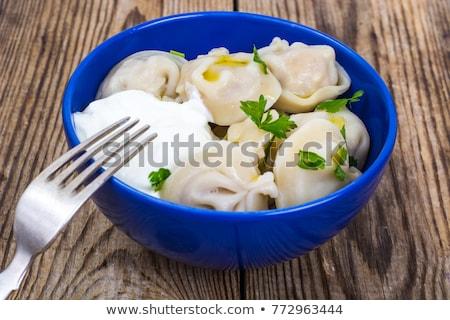 meat pelmeni with sour cream and greens stock photo © zhekos