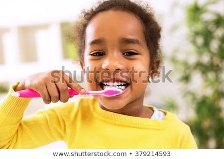 Genç çocuk fırçalamak mavi gömlek ışık Stok fotoğraf © gewoldi