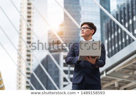 Stock photo: Businessman using a notebook