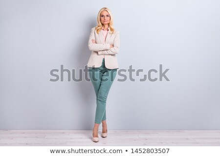 full length view of a middle age lady stock photo © stockyimages