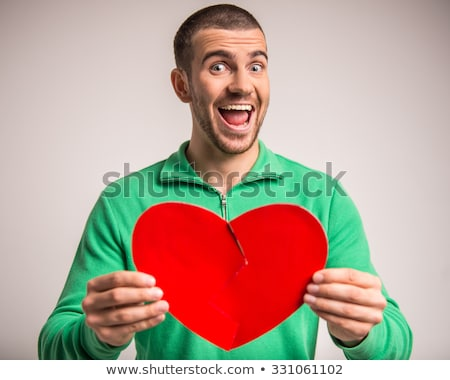 casual · homem · papel · coração · sorridente · isolado - foto stock © stockyimages