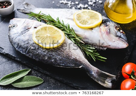 raw red fish with lemon and olive Stock photo © ozaiachin