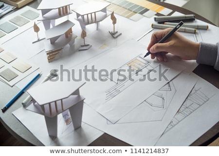 üzletember · gondolkodik · építészeti · tervek · fehér · iroda - stock fotó © photography33