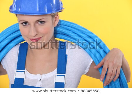 A tradeswoman with tubes coiled around her neck Stock photo © photography33
