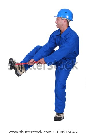 Tradesman unblocking a stoppage using a plunger Stock photo © photography33