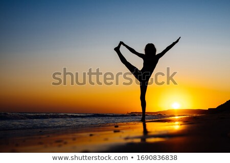 Gymnastics on the beach Stock photo © photography33