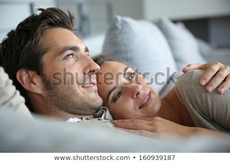 A middle age couple hugging on their couch. Stock photo © photography33