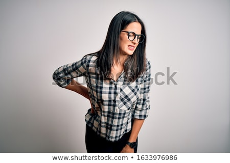 Młoda kobieta cierpienie ból w krzyżu widok z tyłu biały ból Zdjęcia stock © wavebreak_media