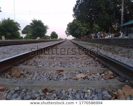 iron rusty train railway detail over dark stones Stock photo © lunamarina