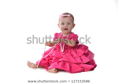прелестный мало розовый платье сидят Сток-фото © ashumskiy