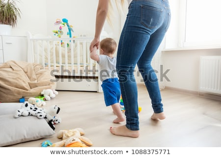 mother holding little baby child boy making first step stock photo © ia_64