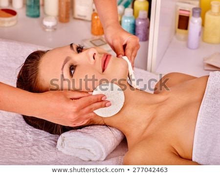 Woman under facial treatment at beauty spa Stock photo © d13
