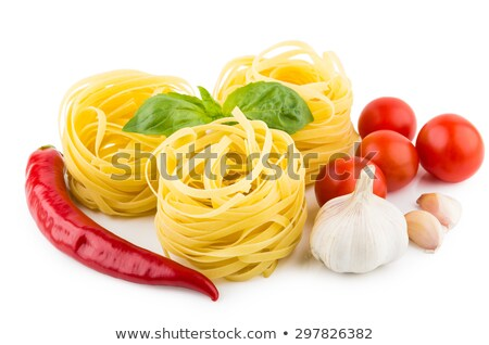 red ripe tomato in pasta nest stock photo © dariazu