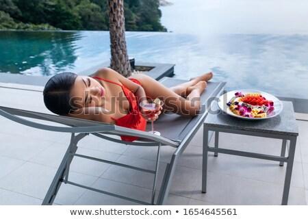 Gorgeous Woman in Bikini Lying at Poolside Stock photo © dash