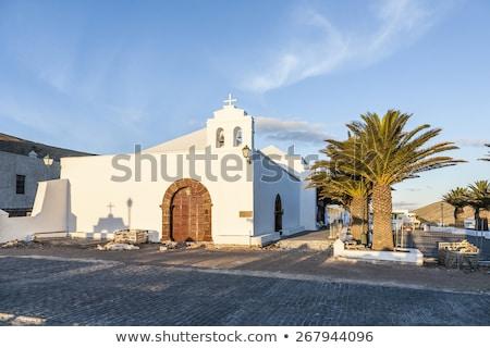 Templom kicsi falu késő délután naplemente Stock fotó © meinzahn
