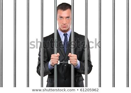 Handcuffed hands on white background Stock photo © Elnur