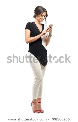 Young businesswoman with mobile on white background studio stock photo © ambro