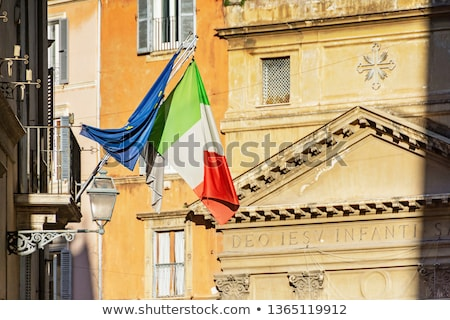 flags of italy and european union waving in rome italy stock photo © vladacanon