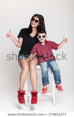 káprázatos · fiatal · nő · hódeszka · visel · napszemüveg · ül - stock fotó © feedough