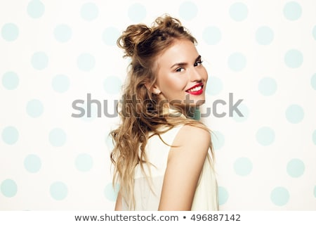 smiling young woman with pink lipstick on lips stock photo © dolgachov