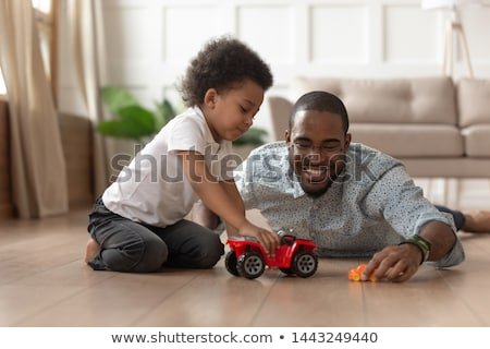 father and son playing with toys at home stock photo © deandrobot