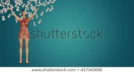 asian woman catching money falling from the sky stock photo © kentoh