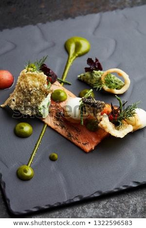 Delicioso salmão aperitivos dourado caviar servido Foto stock © Klinker