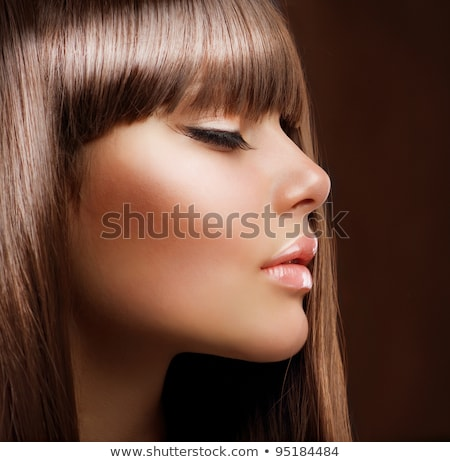Beautiful young woman with perfect skin and face (color toned im Stock photo © lightpoet