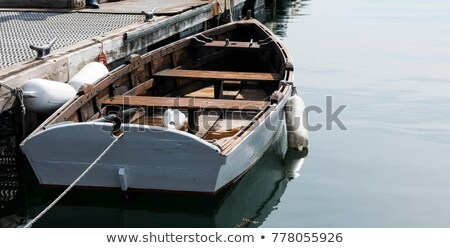 Small wooden boats docked and tied to empty pier Stock photo © stevanovicigor