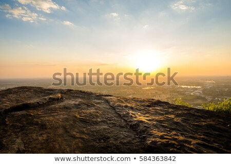 City in a mountain valley and the sunrise view from above stock photo © alinamd