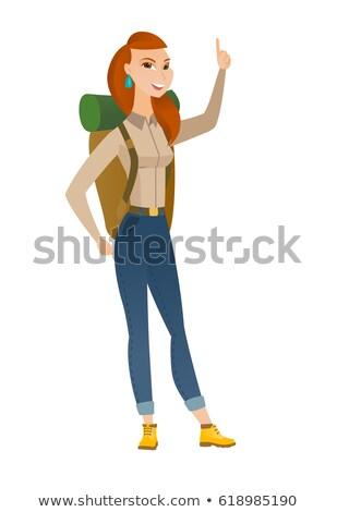 African traveler pointing with her forefinger. Stock photo © RAStudio