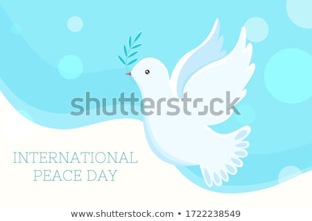 Peace day greeting card with flying dove and symbols of hope Stock photo © ussr