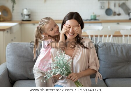 Mother and daughter on sofa in a field Stock photo © IS2