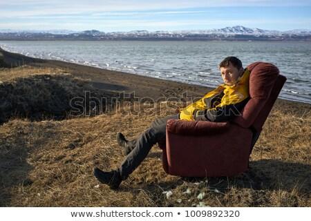 Guys on faded seashore Stock photo © bezikus