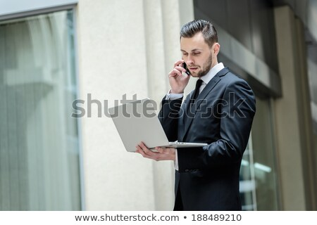 businessman with laptop case happy stock photo © is2