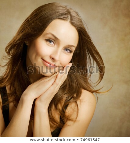 Close up beauty portrait of a surprised brown haired woman Stock photo © deandrobot