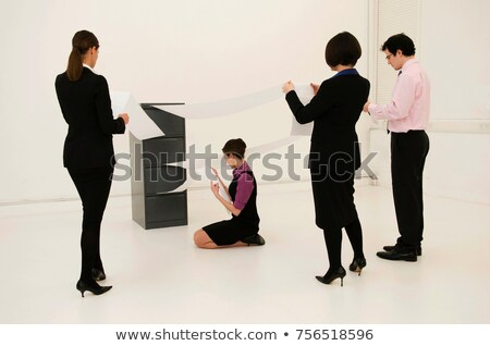 4 workers look for data in cabinet Stock photo © IS2