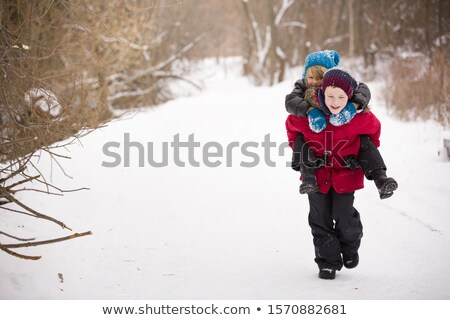 One boy piggybacking the other Stock photo © IS2