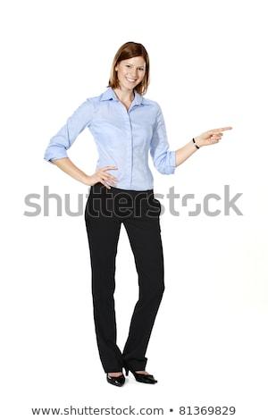 friendly businesswoman showing something stock photo © minervastock
