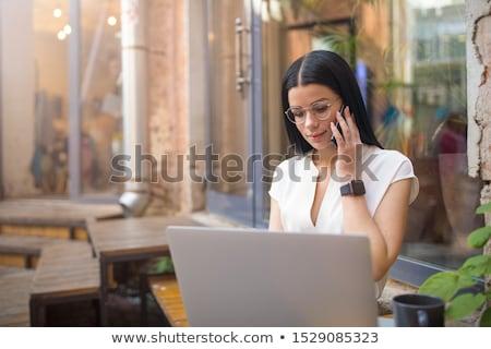 female editor using cellphone stock photo © andreypopov