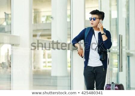 homem · falante · telefone · móvel · avião · sorrir · paisagem - foto stock © dolgachov