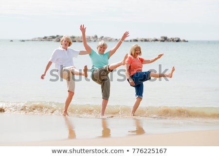 A Loving life woman at the beach Stock photo © Lopolo