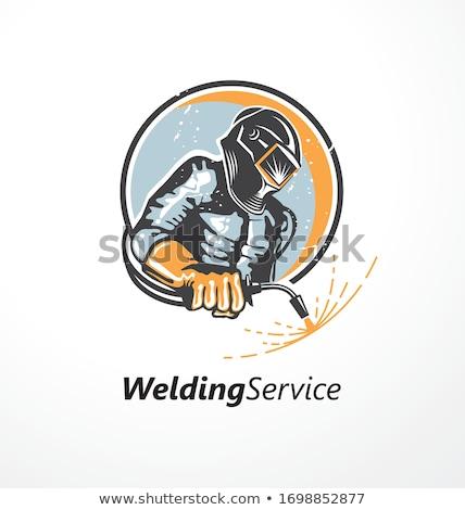 Welder holding metal mask Stock photo © colematt
