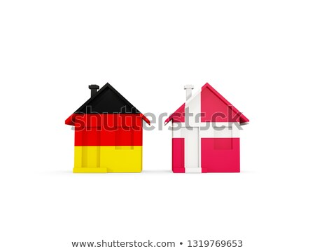 Two houses with flags of Germany and denmark Stock photo © MikhailMishchenko