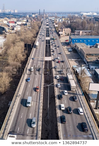 Highway with moving cars and trucks in the city Kiev, Ukraine. Aerial view from drone in a spring da Stock photo © artjazz