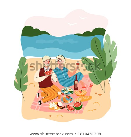 Summer Vacation, Couple Eating near Sea Shore Photo stock © robuart