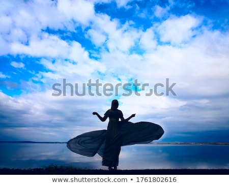 Shapely young woman with long hair dancing outdoor relaxing with smile and eyes closed. Portrait of  Stock photo © ElenaBatkova