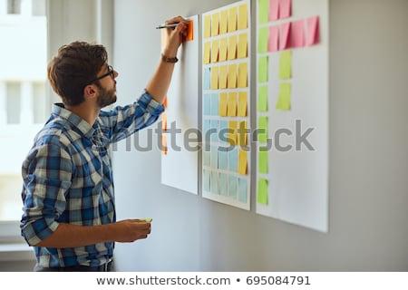 student guy writing ideas down stock photo © pressmaster