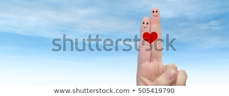couple hugging over sky and heart shaped cloud Stock photo © dolgachov