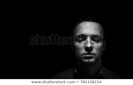 Black and white portrait of man with closed eyes, low key. Stock photo © lichtmeister